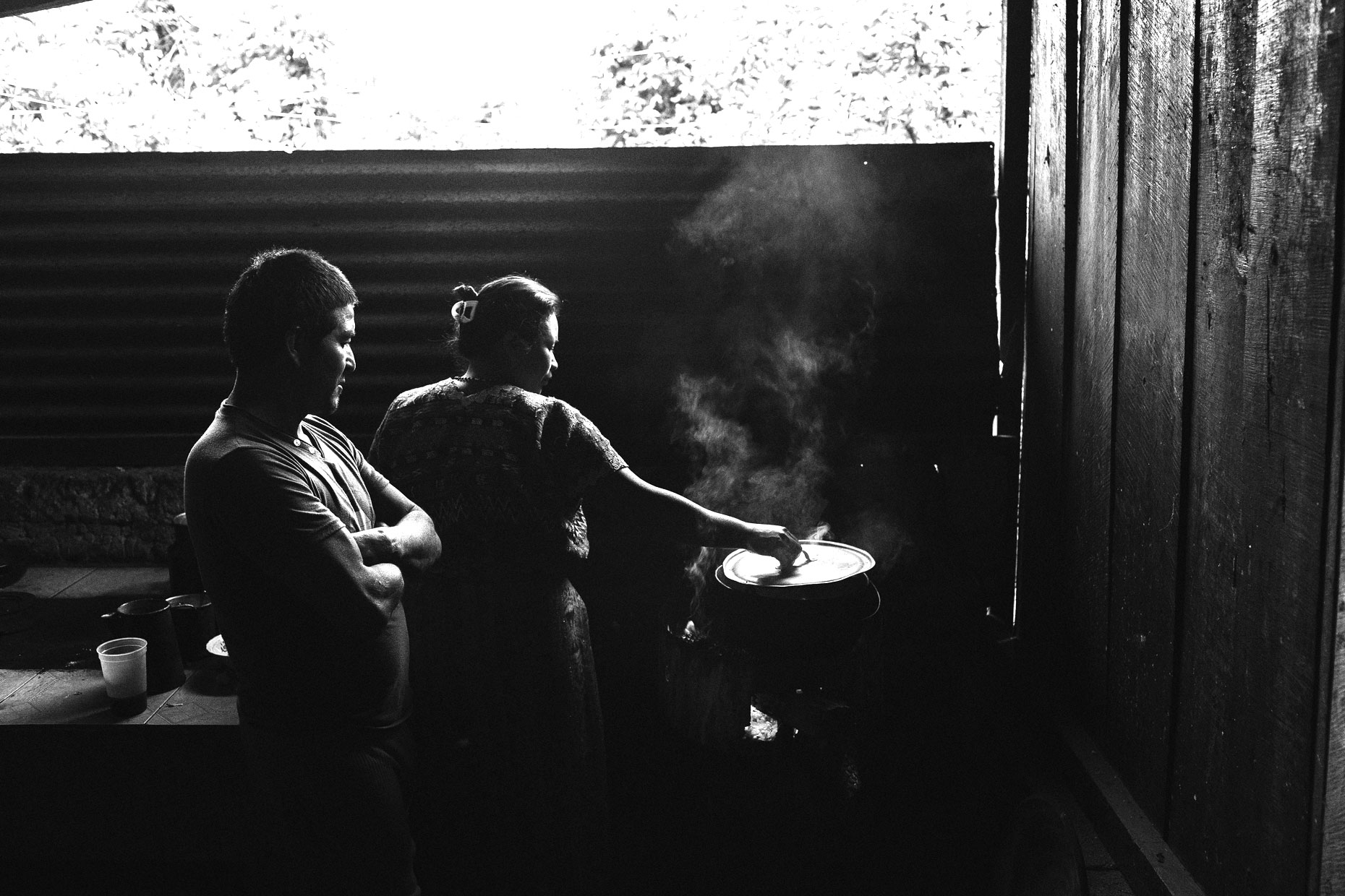 Guatemalan family cooking in kitchen