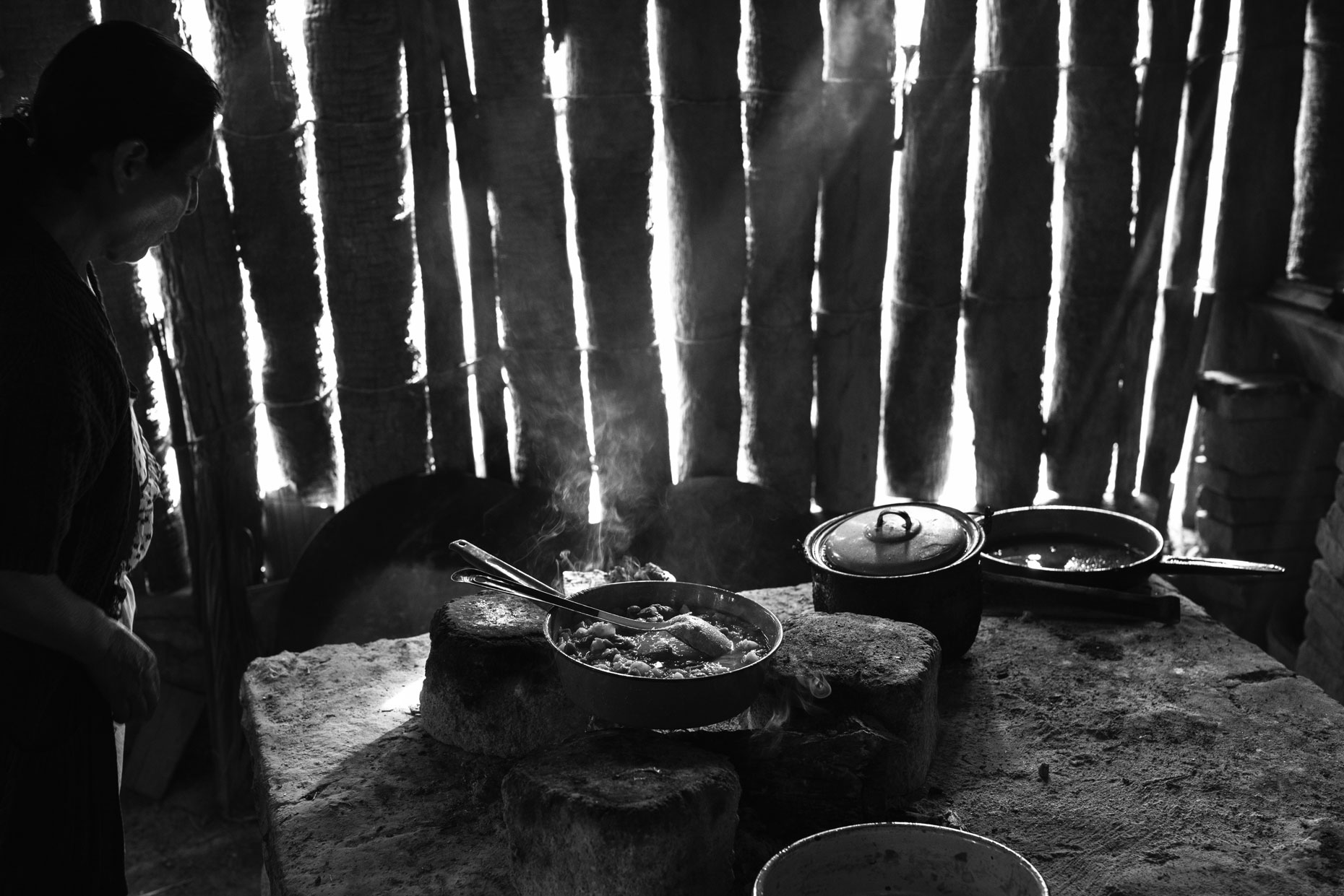 Mexican woman cooking in her house  in the mountains of Oaxaca