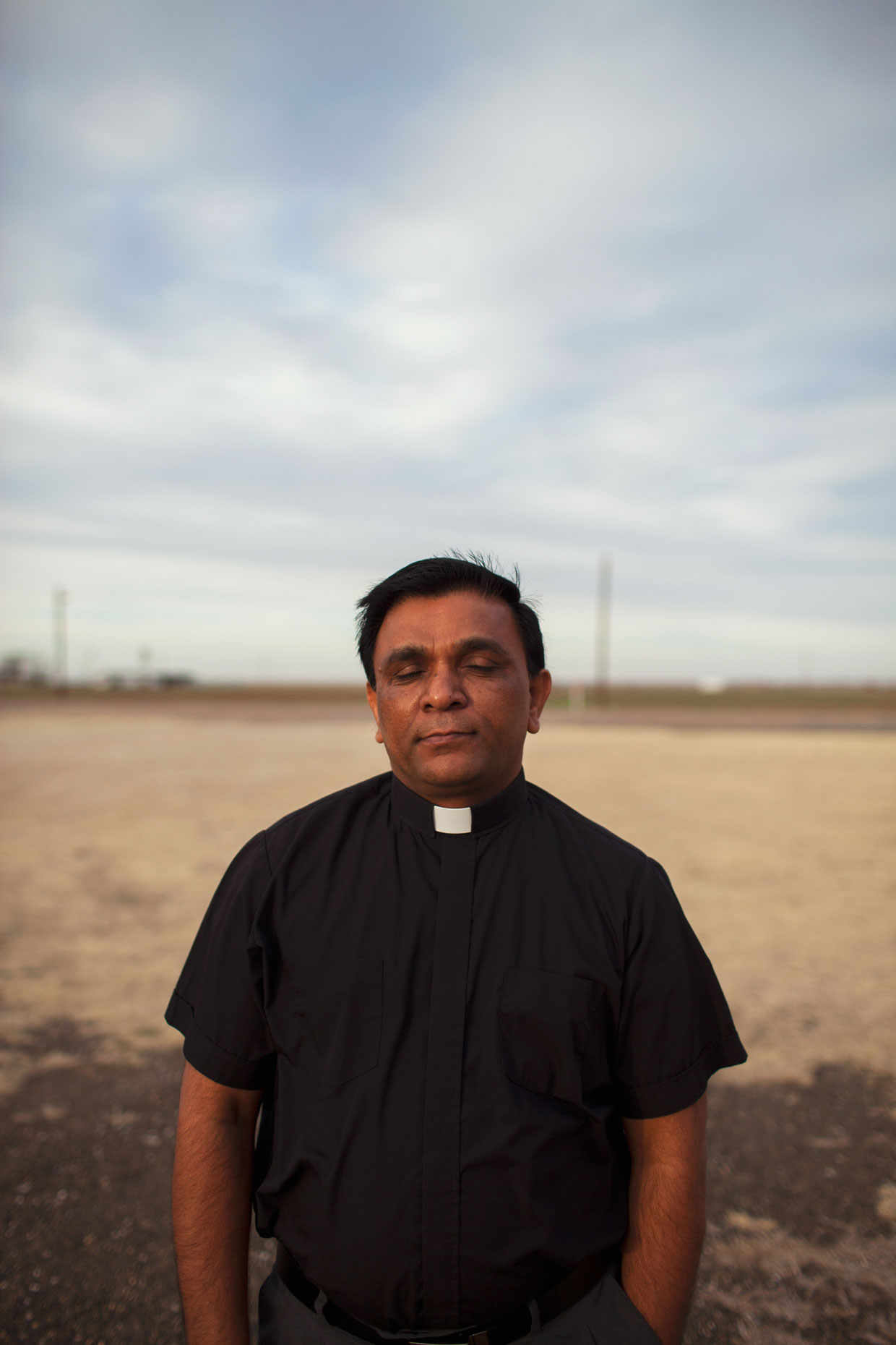 Indian priest outside his Catholic Church in White Deer in the Texas Panhandle